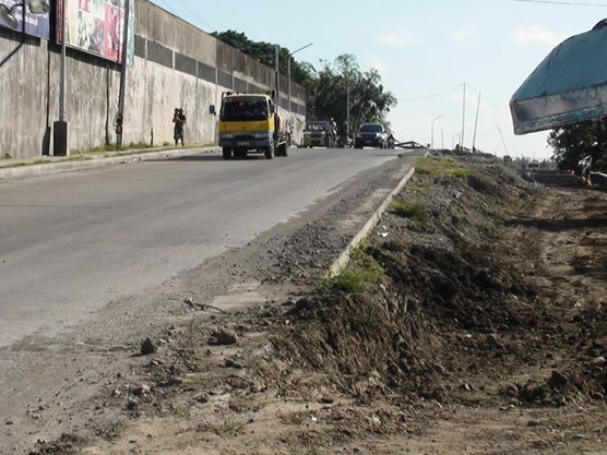 """This is the road section of the Iloilo City Circumferential Road in Ungka, Jaro. From the corner to the bridge is only 300 lineal meters. The contract for the backfilling (""""Tambak"""") alone was P14 million."""